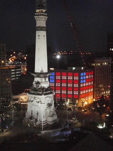 Monument lit and building lit like an American flag