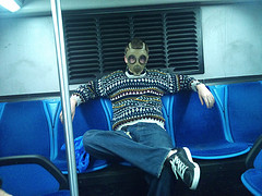 Must be stinky on the bus to wear a gas mask. LOL!