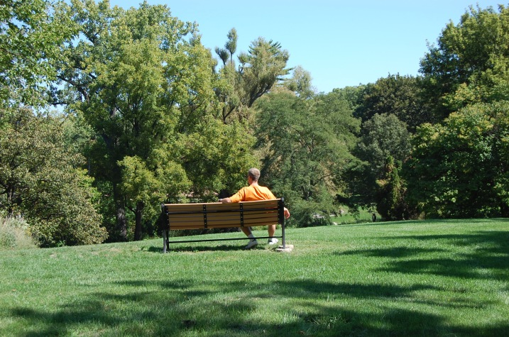 Mike sitting on a bench enjoying the day