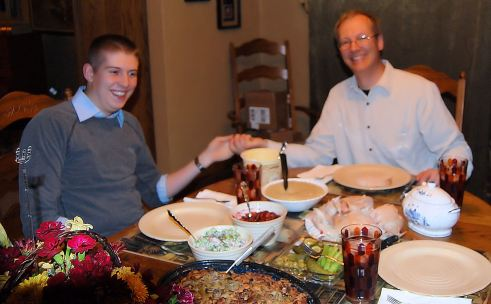 The guys goof off at the table.  It's my family tradition to take pictures of holiday table before anyone eats.  We have 3 generations of them.  However my group no longer does good china nor do we take it seriously any more.