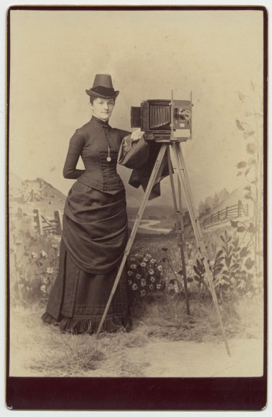 Woman with Camera from the George Eastman House on Flickr The Commons.  There are no known copyright restrictions.