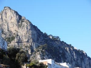 If you look there on the side of the rock you'll see the Etruscan road to Anacapri.  See it there with the supports?
