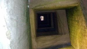 Looking up a Roman well that 1600 nuns turned into a narrow stairwell to their storage.