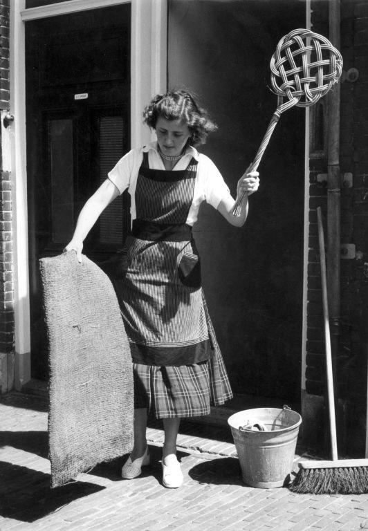 House Wife with carpet beater, no known copyright restrictions, Used via The Commons on Flickr From the Nationaal Archief of the Netherlands.