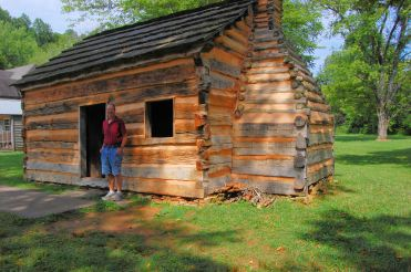 Mike in front of replica of Lincoln's childhood home in Knob Creek Kentucky.